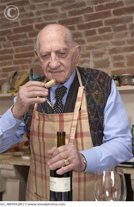 Senior_man_sniffing_wine_cork_tm_400104